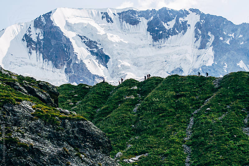 People hiking in Caucasus mountains  by Ilya for Stocksy United