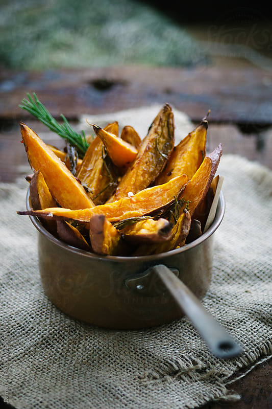Sweet potato fries.  by Darren Muir for Stocksy United