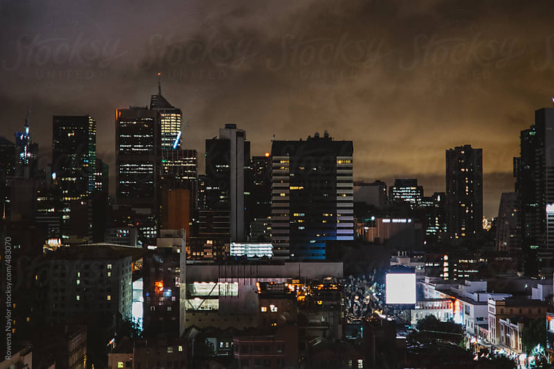 Looking out over Melbourne CBD at night by Rowena Naylor for Stocksy United