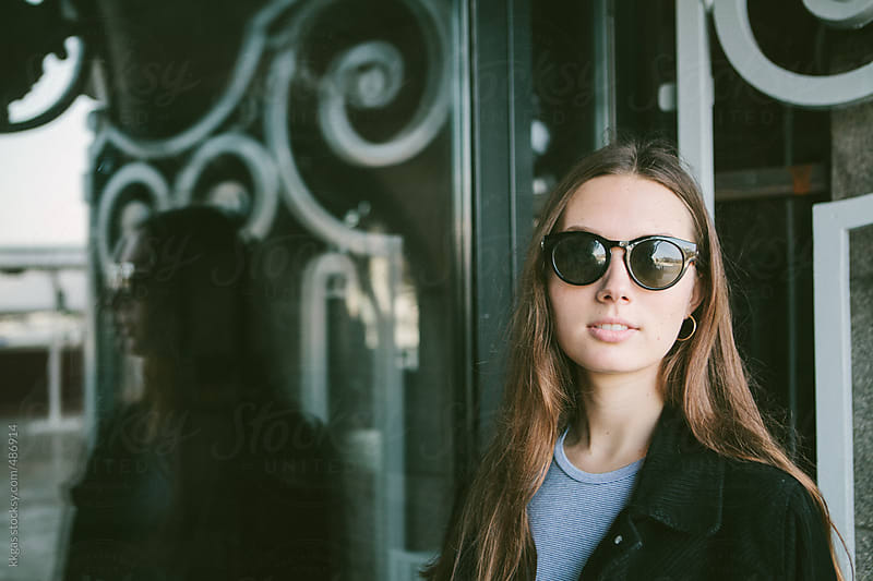 Young woman wearing sunglasses by kkgas for Stocksy United