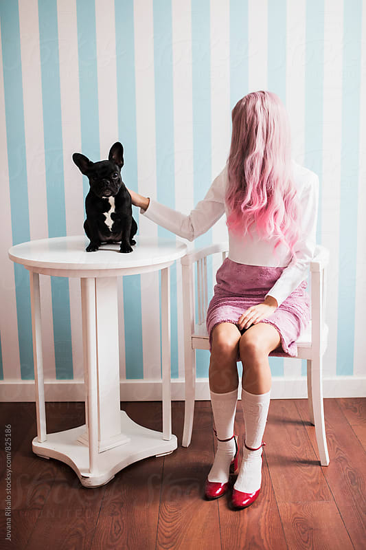 Fashionable young woman with pink hair and french bulldog by Jovana Rikalo for Stocksy United