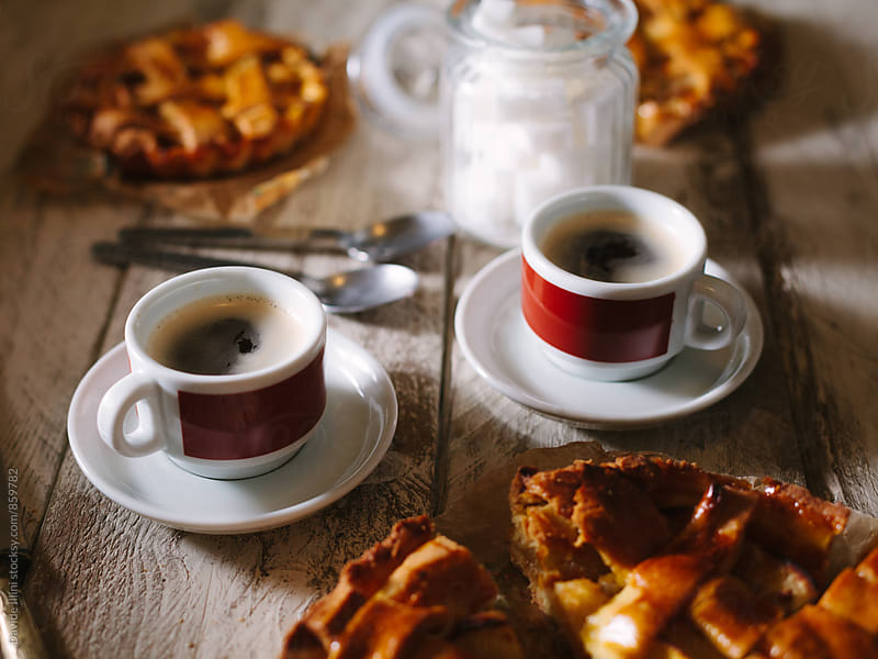 Two espresso with apple tart by Davide Illini for Stocksy United