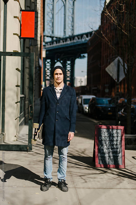 Skateboarder portrait in Dumbo, Brooklyn  by Cameron Whitman for Stocksy United
