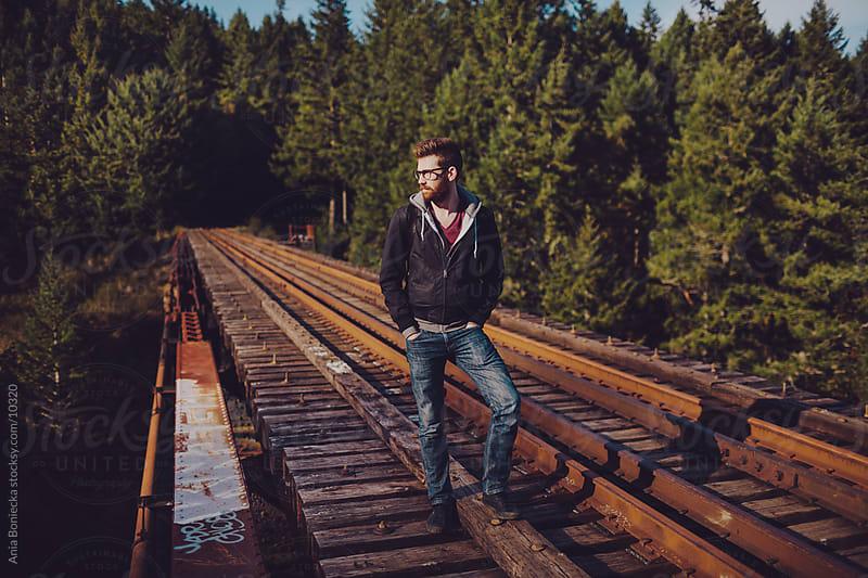A man standing on a tressle by Ania Boniecka for Stocksy United