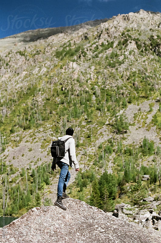 Man hiking by Milles Studio for Stocksy United