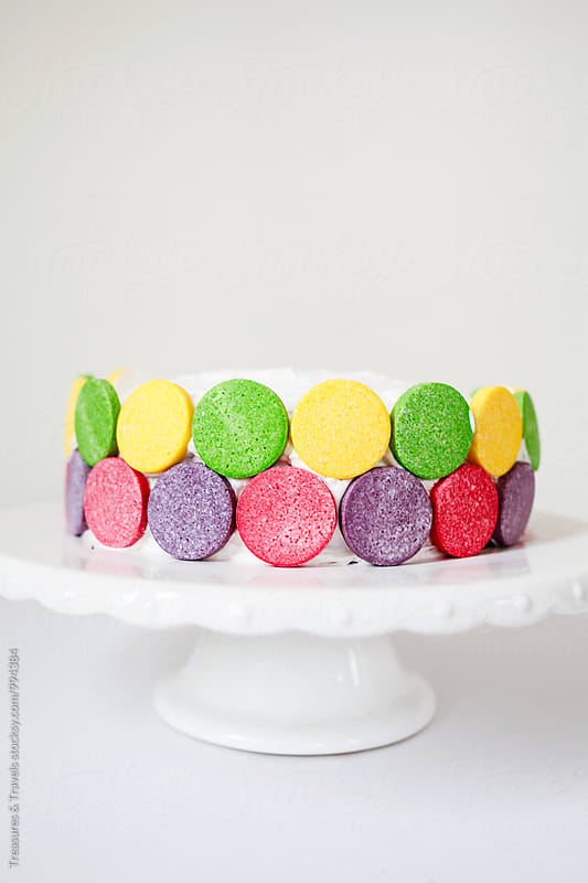 colourful birthday cake  by Treasures & Travels for Stocksy United