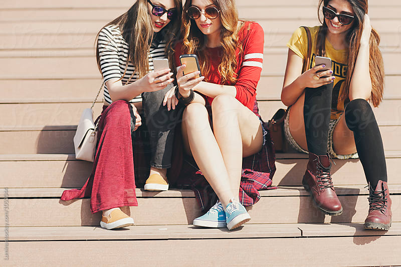Girls Sitting on the Stairs by Lumina for Stocksy United