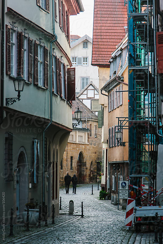 Construction on the side of a building on a narrow cobblestone street, Esslingen, Germany, Baden-Wür by Holly Clark for Stocksy United