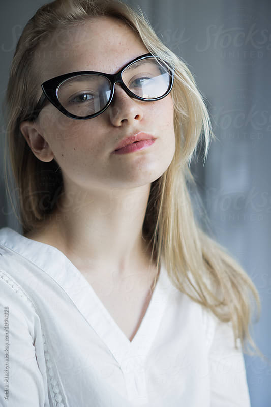 beautiful young girl in glasses close-up by Andrei Aleshyn for Stocksy United