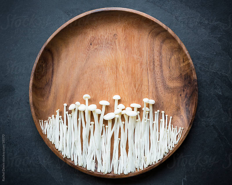 Oriental Japanese Enoki mushrooms. by Rachel Dewis for Stocksy United