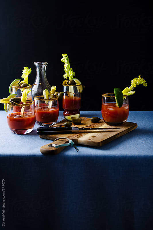 Bloody Mary cocktails on a table. by Darren Muir for Stocksy United