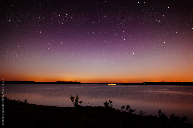 Sunset/Night Sky over Lake by michelle edmonds for Stocksy United