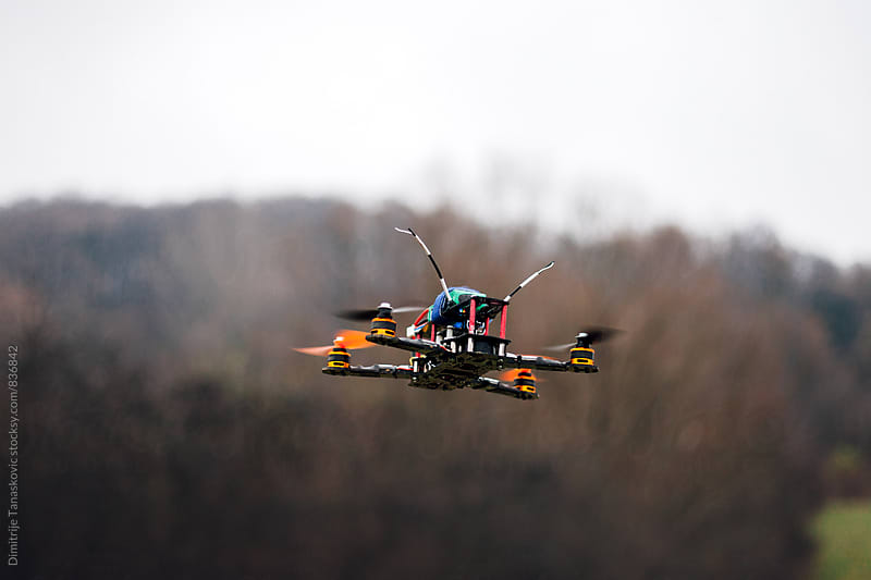 Small drone in the air by Dimitrije Tanaskovic for Stocksy United