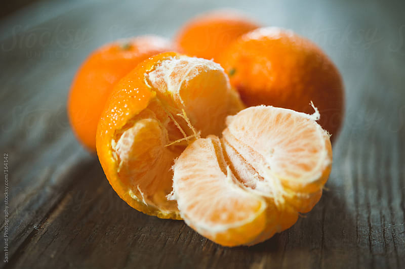 Freshly Peeled Tangerines by Sam Hurd Photography for Stocksy United