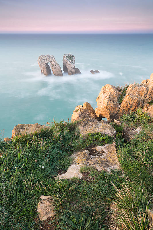 Beautiful sea view from a cliff with some haze by Marilar Irastorza for Stocksy United