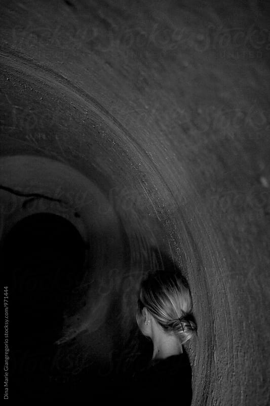 Conceptual Artistic View Of Girl In Tunnel by Dina Giangregorio for Stocksy United
