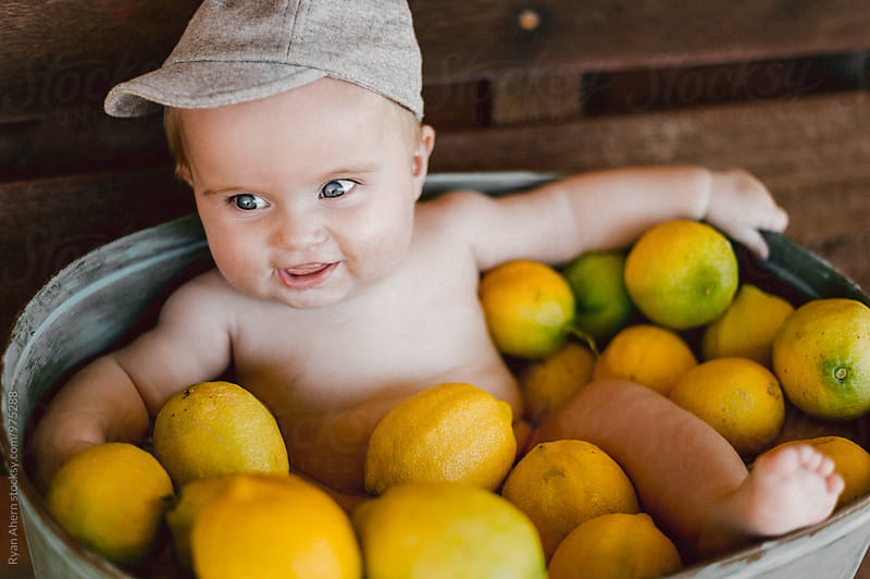 Baby in a Lemon Bucket by Ryan Ahern for Stocksy United