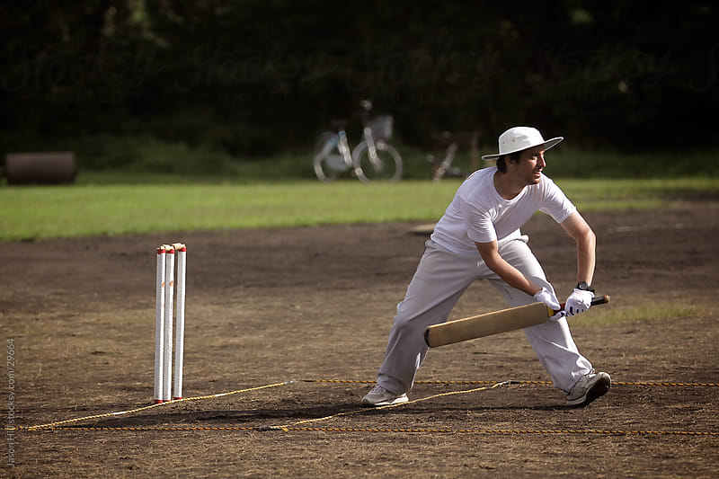 Cricket Player in Japan by Jason Hill for Stocksy United