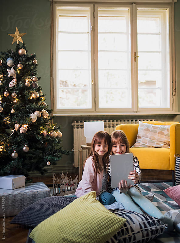 Sisters Take a Selfie With a Tablet at Christmas by Lumina for Stocksy United