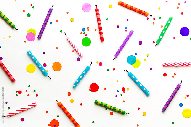 Birthday candles and confetti by Ruth Black for Stocksy United