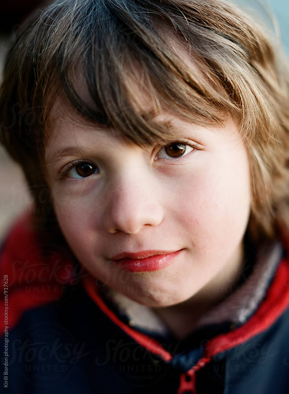 smiling boy by Kirill Bordon photography for Stocksy United