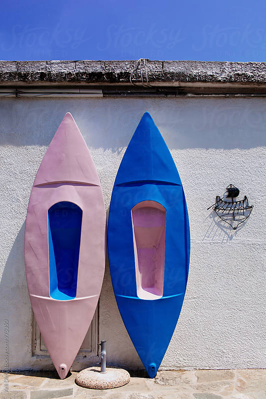 Canoes on the wall by Ani Dimi for Stocksy United