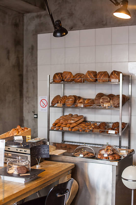 Modern Bakery with Baked Bread on the Shelf  by Mosuno for Stocksy United