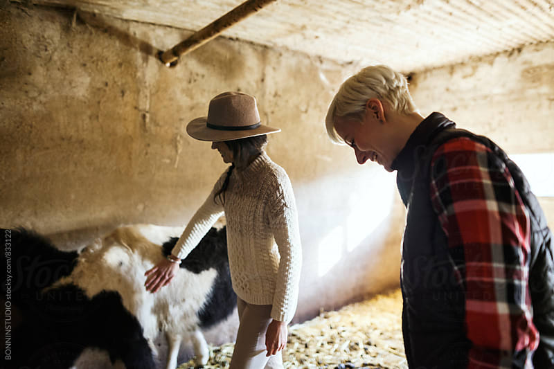 Women farmers taking care ponies on farm. by BONNINSTUDIO for Stocksy United