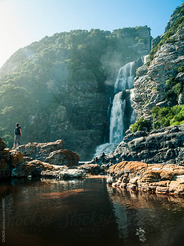 Man viewing waterfall in Tsitsikamma National Park on the Otter Trail near Storms River Mouth  by DV8OR for Stocksy United