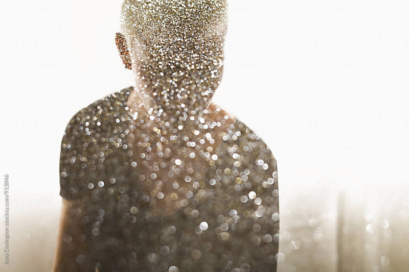 Double Exposure of a woman and gold glitter by Amy Covington for Stocksy United
