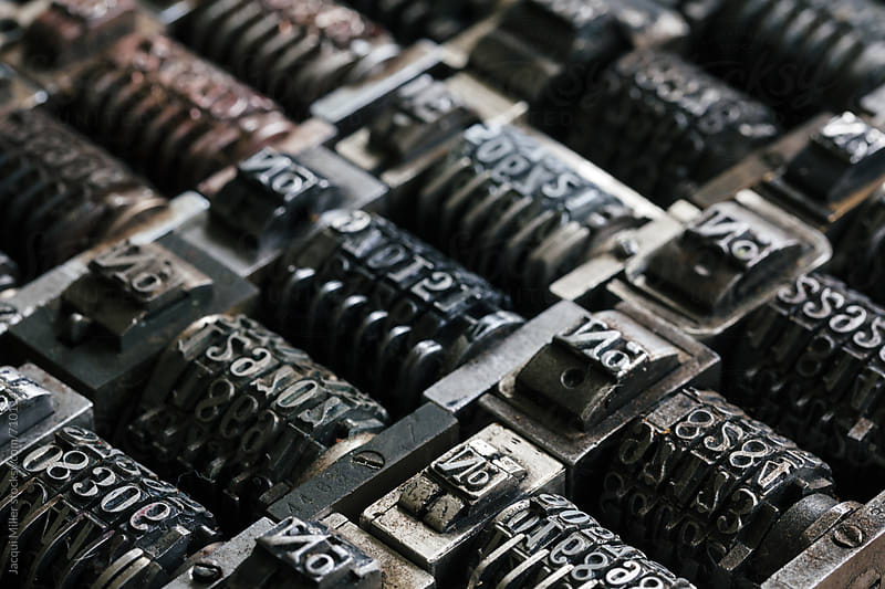 Macro of vintage metal numbering inserts for printer - horizontal by Jacqui Miller for Stocksy United
