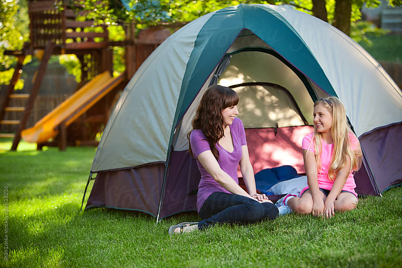 Camping: Mother and Daughter Talk in Backyard by Sean Locke for Stocksy United