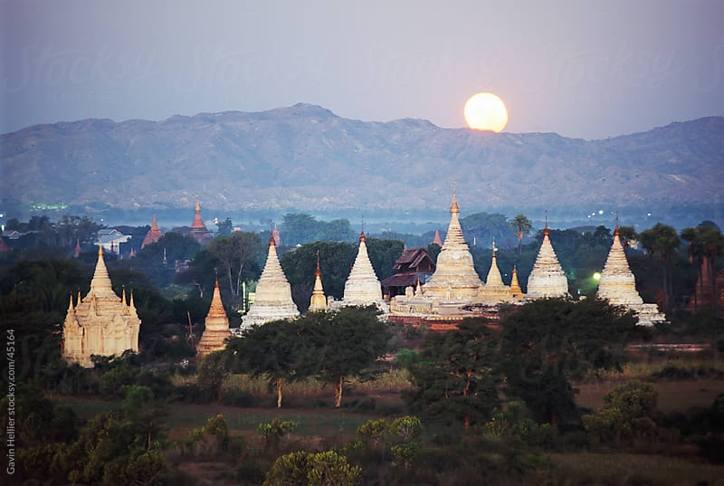Moon rising over the Buddhist temples and pagodas at archaeological site, Bagan (Pagan), Myanmar (Burma), Asia by Gavin Hellier for Stocksy United