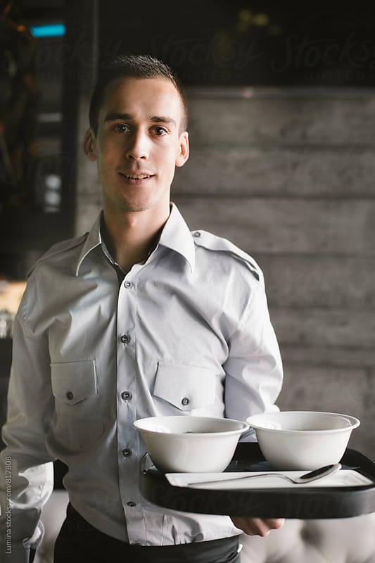 Waiter With a Tray by Lumina for Stocksy United