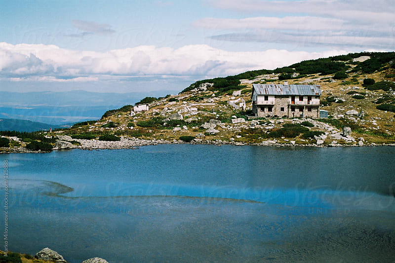 Abandoned hotel on lake in the mountain, house by Marko Milovanović for Stocksy United