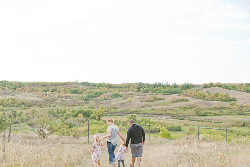 Young family walking together. by Carey Shaw for Stocksy United