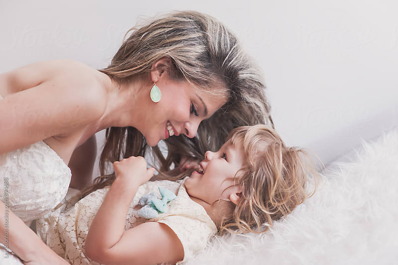Beautiful mother playing with her cute daughther by Lea Csontos for Stocksy United