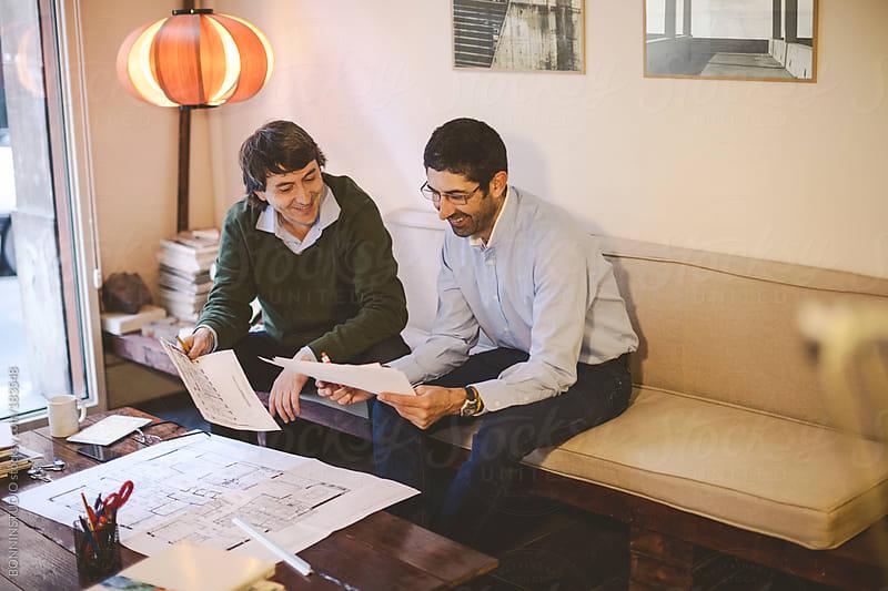 Two interior designer man working in his creative studio.  by BONNINSTUDIO for Stocksy United