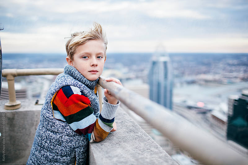 portrait of a handsome boy in the city by Kelly Knox for Stocksy United
