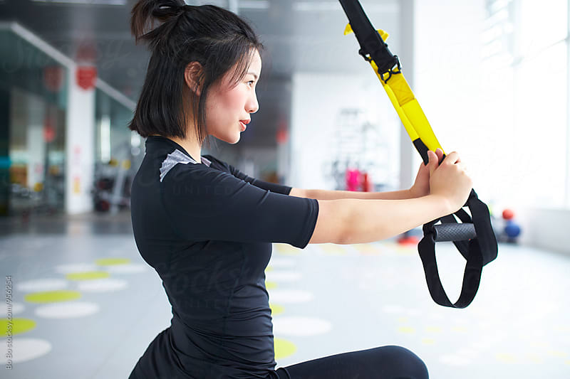 young asian woman in gym by Bo Bo for Stocksy United