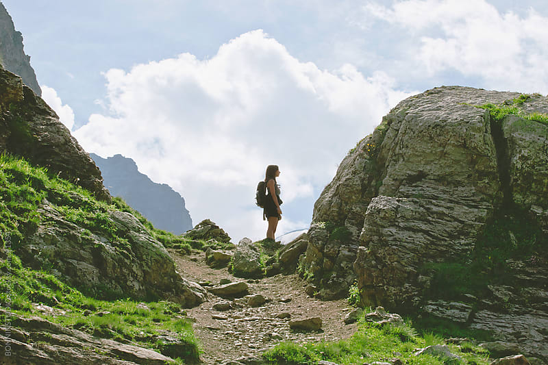 Hiker woman on beautiful Alps landscape. by BONNINSTUDIO for Stocksy United