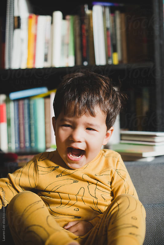 Toddler laughing by Lauren Naefe for Stocksy United