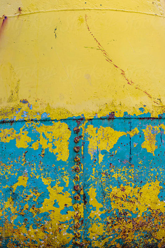 Yellow and blue marine buoy abstract of corrosion by Paul Phillips for Stocksy United