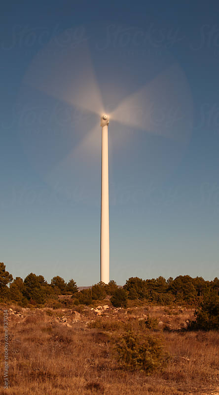 A wind turbine in Spain by Sara Wager for Stocksy United