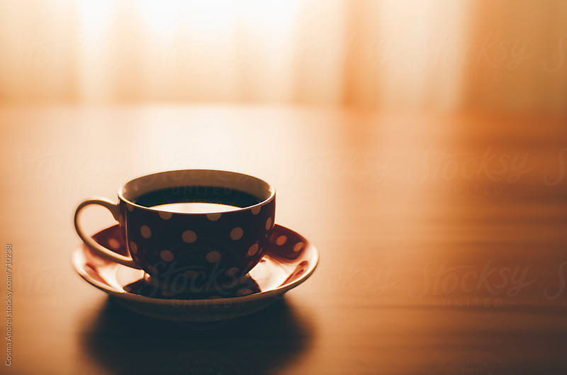 Morning coffee cup in morning light by Cosma Andrei for Stocksy United