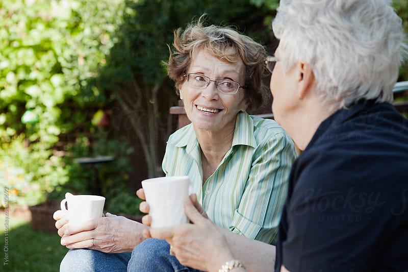 Senior Women Talking over Coffee by Tyler Olson for Stocksy United