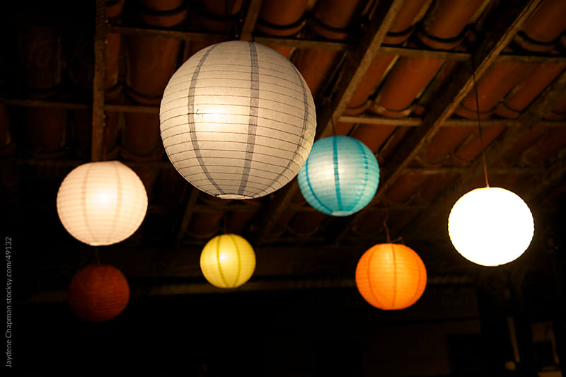 Colourful rainbow paper lantern lights on the ceiling, Ilha Grande, Brazil by Jaydene Chapman for Stocksy United