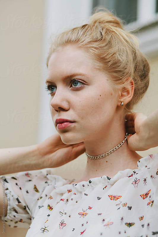 Portrait of a beautiful blonde girl with an jewel on a neck by Sergey Filimonov for Stocksy United