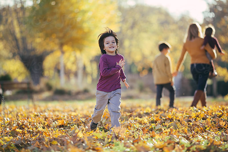 Happy child running in park. by Dejan Ristovski for Stocksy United