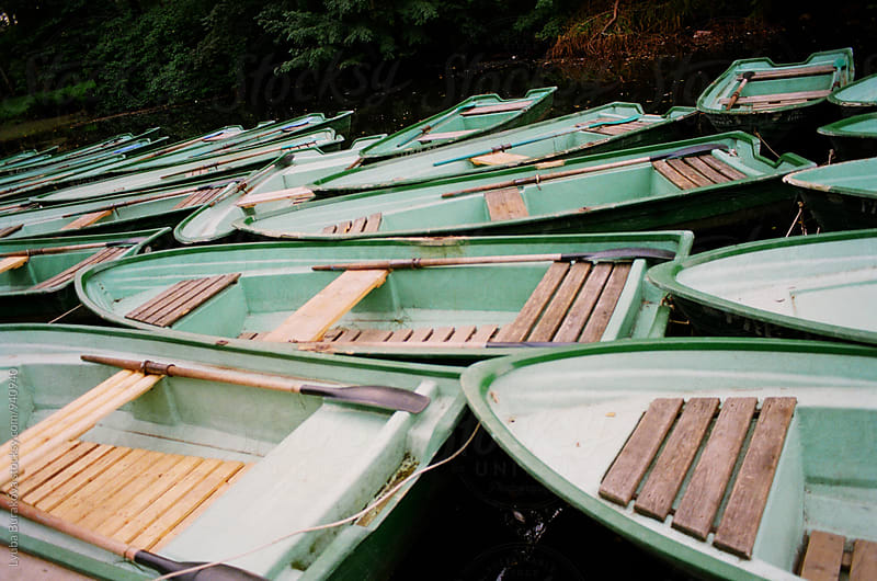 Green old boat on a dock by Lyuba Burakova for Stocksy United